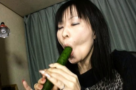 Milf enjoying a cucumber