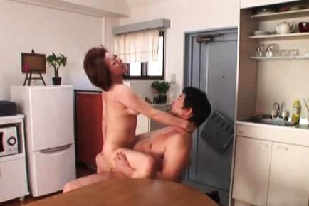 Mature housewife Reiko Yamaguchi gets crazy kitchen sex