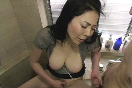 Mature Japanese woman Kyoko Misaki plays with herself in the bathroom