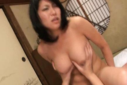 Enthusiastic mature Kyoko Takashima gives deep and hard blowjob