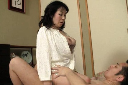 Hot mature Japanese AV Model in bondage gets tit fuck