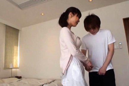Mature Midori Nashiro shows her big tits while beating him off