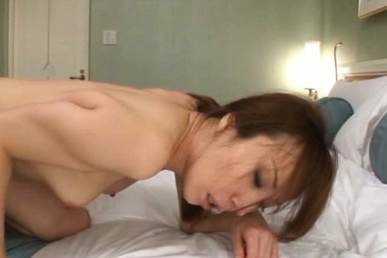 Hot and kinky Japanese mature cutie opens her legs for cock