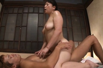 Mature koitoka enjoys young hunk slaming her hairy cunt