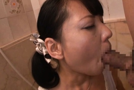Mature Emiko Ejima blows a strong cock in the shower