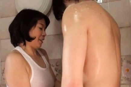 Horny Asian MILF Rie Takahashi sucks a young stud in the bathroom
