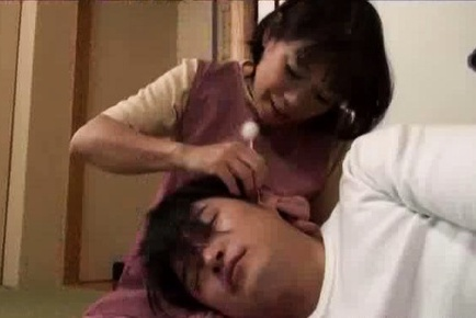 Mature babe Rie Takahashi gives a young stud a sensual blowjob